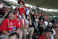 United States Men's National team fans cheer against some Mexican fans heckling them before the start of the game at Azteca stadium. The United States Men's National Team played Mexico in a CONCACAF World Cup Qualifier match at Azteca Stadium in, Mexico City, Mexico on Wednesday, August 12, 2009.