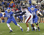 Freshman holder Jared Leet defends the ball in the second half of the UK vs Samford at Commonwealth Stadium in Lexington, Ky., on Saturday, November 17th, 2012. Photo by Logan Douglas | Staff.