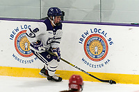 WORCESTER, MA - FEBRUARY 08: Katie MacCuaig #6 of Holy Cross brings the puck forward during a game between Boston University and College of the Holy Cross at Hart Center Rink on February 08, 2020 in Worcester, Massachusetts.