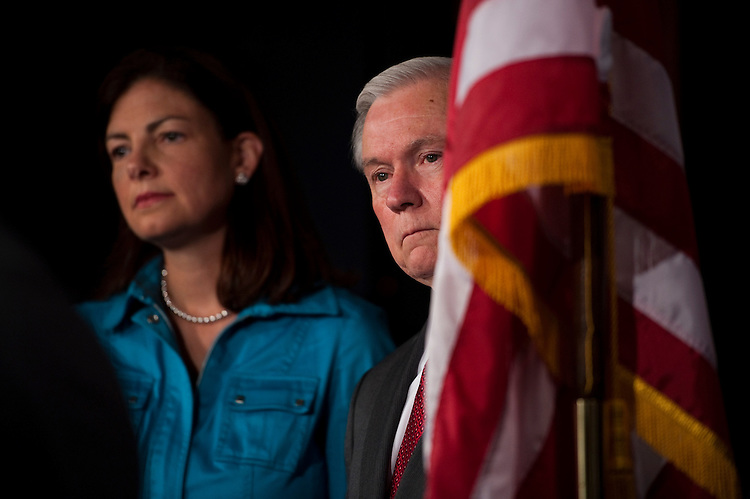 WASHINGTON, DC - July 05: Sen. Kelly Ayotte, R-N.H., and Sen. Jeff Sessions, R-Ala., during a news conference after Senate leaders pulled from the floor a resolution (S J Res 20) authorizing limited U.S. military engagement in Libya when it became clear that Republicans -- including co-sponsors of the measure -- would stage a filibuster to make a point about the larger deficit debate consuming Washington. (Photo by Scott J. Ferrell/Congressional Quarterly)