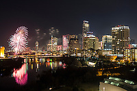 Austinites Celebrate the New Year in Austin with a spectacular fireworks display over downtown Austin Skyline and Lady Bird Lake.