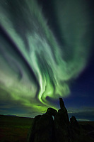 Aurora borealis displays over the weathered granite tors on the ridges in the Bering Land Bridge National Preserve, Seward Peninsula, Alaska.