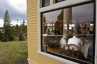 Park visitors fill a dining room at the historic Lake Hotel in Yellowstone National Park Monday, May 30, 2005. Yellowstone, the nation's first national park as well as its most popular, attracts millions of visitors each year. Booking lodging in the park is difficult, and confusing online sources can complicate the task. (Kevin Moloney for the New York Times)