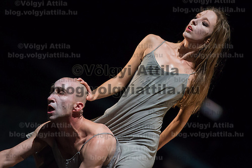 Dancers perform during the dress rehearsal of the piece Orpheus and Eurydice by Hungarian choreographer Yvette Bozsik in Budapest, Hungary on November 16, 2012. ATTILA VOLGYI