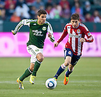 CARSON, CA – June 3, 2011: Portland Timbers midfielder Sal Zizzo (7) moves the ball past Chivas USA midfielder Jorge Flores (19)   during the match between Chivas USA and Portland Timbers at the Home Depot Center in Carson, California. Final score Chivas USA 1, Portland Timbers 0.