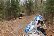 April 2010, Pemigewasset Wilderness - Remnants of the suspension bridge that once crossed the East Branch of Pemigewasset River along the Wilderness Trail at the Trestle 17 location (East Branch & Lincoln Railroad) in Lincoln, New Hampshire USA. The bridge was removed because of safety issues. Seen here in 2010, this debris was eventually removed from the wilderness.
