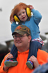 Margaret Hand tries on sound-reducing headphones at her first air show as her father, Garth Hand, watches planes flying overhead at the Spirt of St. Louis Air Show & STEM Expo held on Saturday October 13, 2018 at the airport located in Chesterfield, MO. They are from St. Peters.<br /> Photo by Tim Vizer