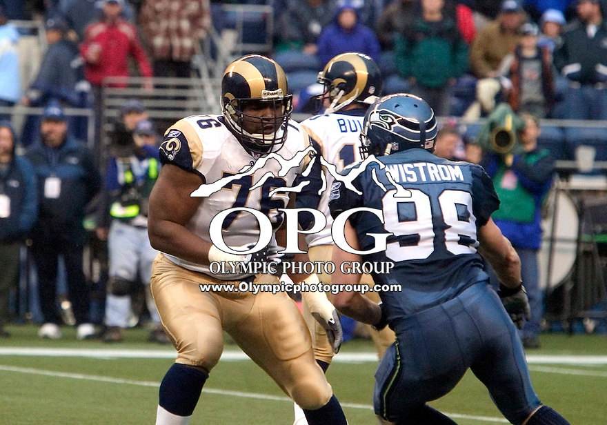 13 Nov 2005:   St. Louis Rams tackle #76 Orlando Pace moves into position to block Defensive end Grant Wistrom of the Seattle Seahawks at Quest Field in Seattle, WA.