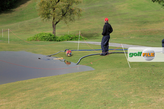 Clearing the water from the 9th green during Round 1 of the NH Collection Open at the La Reserva de Sotogrande Club de Golf in Cadiz Spain on Thursday 3rd April 2014<br /> Picture:  Thos Caffrey / www.golffile.ie