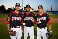 Batavia Muckdogs relief pitcher Brett Lilek, starting pitcher Gabriel Castellanos and relief pitcher Steven Farnworth (L-R) pose for a photo after completing the first perfect game in team history against the Mahoning Valley Scrappers on June 24, 2015 at Dwyer Stadium in Batavia, New York.  Batavia defeated Mahoning Valley 1-0.  (Mike Janes/Four Seam Images)