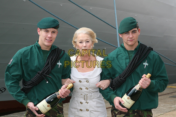 DAME HELEN MIRREN & ROYAL MARINE COMMANDOS.P&O Ventura - photocall, cruise shp naming ceremony, Southampton Dock Mayflower Cruise terminal, Southampton, England..April 16th, 2008.half length grey gray silver jacket skirt  green uniform top hat champagne bottles beverage drink rope .CAP/DS.©Dudley Smith/Capital Pictures