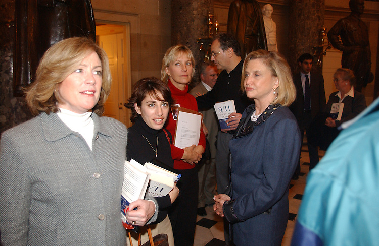 12/06/04.INTELLIGENCE REFORM BILL--Family members Mary Fetchet, Carie Lemack, Beverly Eckert, Charlie Wolf (background), and  Carolyn B. Maloney, D-N.Y., with other family members wait in Statuary Hall to deliver a petition to House Speaker J. Dennis Hastert, R-Ill., urging him to schedule a vote on the intelligence reform bill before the imminent end of the 108th Congress..CONGRESSIONAL QUARTERLY PHOTO BY SCOTT J. FERRELL