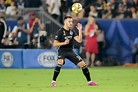 CARSON, CA - SEPTEMBER 15: Luis Martins #36 of Sporting Kansas City heads a ball during a game between Sporting Kansas City and Los Angeles Galaxy at Dignity Health Sports Complex on September 15, 2019 in Carson, California.