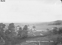 BNPS.co.uk (01202 558833)<br /> Pic: ShaftesburyHistoricalSociety/BNPS<br /> <br /> Pictured: The view from Castle Hill in Shaftesbury at the turn of the 20th century<br /> <br /> These charming photos reveal everyday life at the turn of the 20th century in a thriving market town later made famous by a TV advert.<br /> <br /> The black and white snapshots of Shaftesbury, Dorset, were taken by Albert Tyler who set up a photography business there in 1901.<br /> <br /> There are various street scenes and also images of the locals in traditional attire, with men in flatcaps and women in bonnets.<br /> <br /> Tyler photographed the busy opening of the town market in 1902, and a garden party where men played croquet.