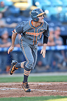 Tennessee Volunteers right fielder Chris Hall (5) runs to first during a game against the UNC Asheville Bulldogs at McCormick Field on March 15, 2016 in Asheville, North Carolina. The Volunteers defeated the Bull Dogs 7-3. (Tony Farlow/Four Seam Images)