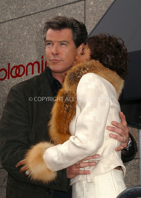 """Pierce Brosnan and Halle Berry stopped by at Bloomingdale's in New York to promote """"James Bond 007"""" themed clothing line. New York, November 5, 2002. Please byline: Alecsey Boldeskul/NY Photo Press.   ..*PAY-PER-USE*      ....NY Photo Press:  ..phone (646) 267-6913;   ..e-mail: info@nyphotopress.com"""