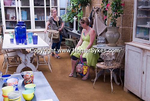 Petersham Nurseries  Richmond Surrey UK. Two women making a shopping choice.