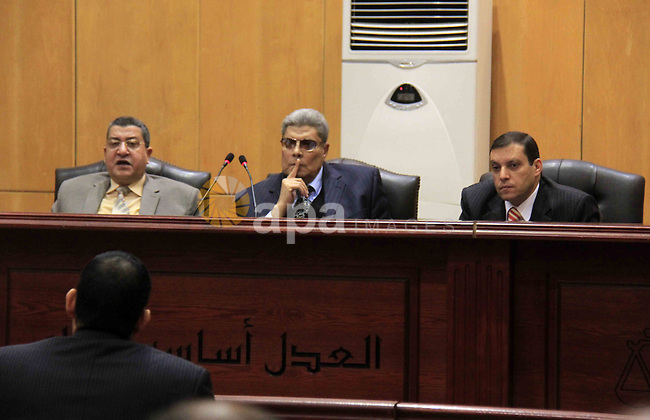 "Judges attend the retrial of Gamal and Alaa Mubarak, sons of former former president Hosni Mubarak in Cairo on April 16, 2015. Cairo Criminal Court held at Police Academy will resume, Gamal and Alaa Mubarak trial in ""Stock Market Manipulation"" case. Gamal and Alaa Mubarak and six other businessmen, who are officials and former members of the board of directors of the National Bank face charges of illegal gains from the sale of National Bank of Egypt, waste of public money, causing huge losses to the economy and destroying the country's banking system through manipulating the stock exchange. Photo by Stringer"