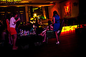 Young women take photos of each other at The club LAP located in Hotel Samrat in New Delhi, India. Photograph: Sanjit Das/Panos