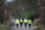 © Joel Goodman - 07973 332324 . No syndication permitted . 27/11/2013 . Manchester , UK . Police patrol the road leading to the site . Energy firm IGas have today (Wednesday 27th November 2013) been receiving drilling equipment in readiness for exploratory drilling at the site . Anti fracking protesters have established a camp at Barton Moss in Greater Manchester alongside an access road leading to an IGas drilling site .  Photo credit : Joel Goodman