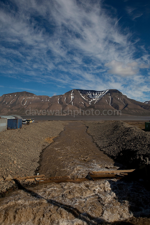 Melt river flowing into Adventfjord, Longyearbyen, Svalbard. The northernmost settlement with more than 1,000 people on earth, and is quite well-serviced town, with an airport and university and hospital.