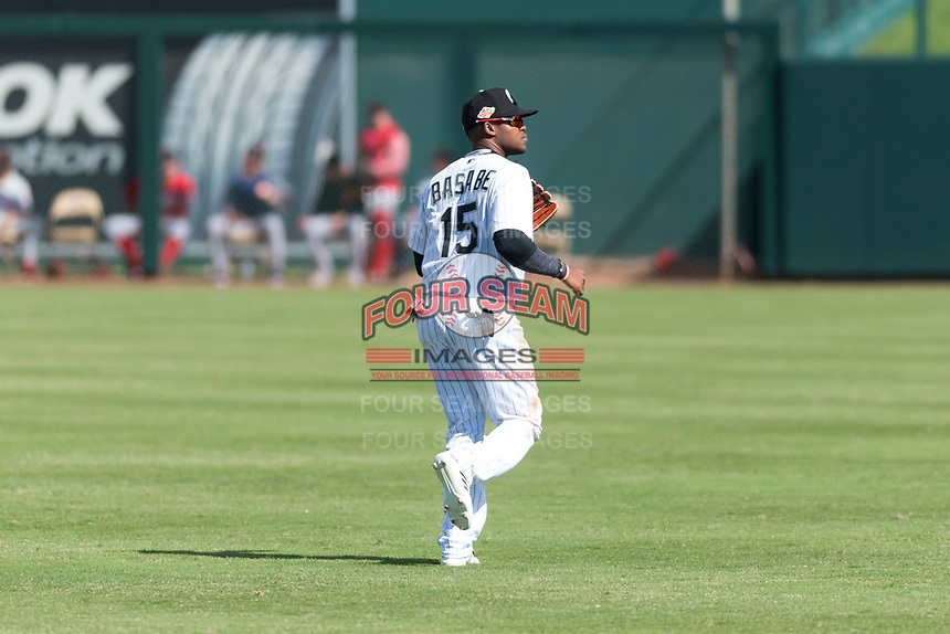 Glendale Desert Dogs center fielder Luis Alexander Basabe (15), of the Chicago White Sox organization, jogs onto the field between innings of an Arizona Fall League game against the Scottsdale Scorpions at Camelback Ranch on October 16, 2018 in Glendale, Arizona. Scottsdale defeated Glendale 6-1. (Zachary Lucy/Four Seam Images)
