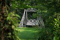 Swinging garden seat in a garden, Chipping, Lancashire.