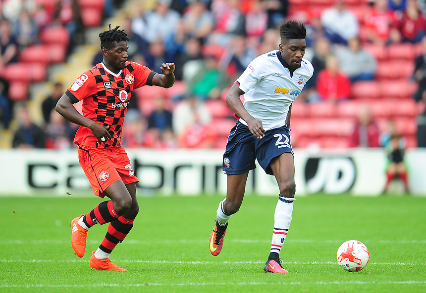 Bolton Wanderers' Sammy Ameobi under pressure from Walsall's Amadou Bakayoko<br /> <br /> Photographer Kevin Barnes/CameraSport<br /> <br /> The EFL Sky Bet League One - Walsall v Bolton Wanderers - Saturday 17th September 2016 - Banks's Stadium - Walsall<br /> <br /> World Copyright &copy; 2016 CameraSport. All rights reserved. 43 Linden Ave. Countesthorpe. Leicester. England. LE8 5PG - Tel: +44 (0) 116 277 4147 - admin@camerasport.com - www.camerasport.com