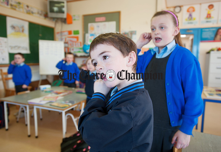 Shay Gleeson and Katie Mc Mahon do the actions for a poem at Coore national School. Photograph by John Kelly.