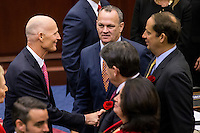 TALLAHASSEE, FLA. 1/12/16-Gov. Rick Scott, left, shakes hands with Sen. Joe Negron, R-Stuart, right, as Rep. Richard Corcoran, R-Land O'Lakes, center, joins them during the opening day of the 2016 legislative session, Tuesday at the Capitol in Tallahassee. <br /> <br /> COLIN HACKLEY PHOTO