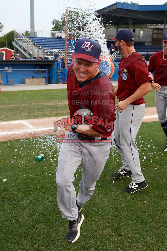 Mahoning Valley Scrappers manager Luke Carlin (11) is doused with water after winning the division title during the second game of a doubleheader against the Batavia Muckdogs on September 4, 2017 at Dwyer Stadium in Batavia, New York.  Mahoning Valley defeated Batavia 6-2 to clinch the Pinckney Division Title.  (Mike Janes/Four Seam Images)