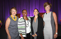NWA Democrat-Gazette/CARIN SCHOPPMEYER Lori Brown (from left), Tracey Brown, Liza Landsman and Sarah Semrow gather at Women's Day at the LPGA breakfast networking event June 22 at the John Q. Hammons Center in Rogers.