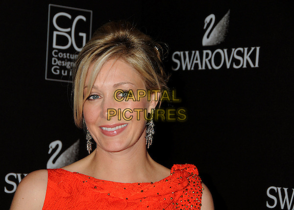 NADJA SWAROVSKI.Attending the 12th Annual Costume Designers Guild Awards held at the Beverly Hilton Hotel.  .Beverly Hills, California, USA,  .25th February 2010 .arrivals portrait headshot red dangly earrings smiling crystals .CAP/ADM/BP.©Byron Purvis/AdMedia/Capital Pictures.