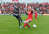 21 April 2012: Chicago Fire forward Dominic Oduro #8 and Toronto FC defender Richard Eckersley #27 in action during the second half in a game between the Chicago Fire and Toronto FC at BMO Field in Toronto..The Chicago Fire won 3-2...