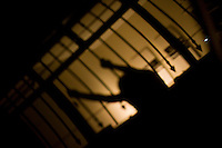 Sao Paulo_SP, Brasil...Silhueta de mulher atras do portao...A woman silhouette behind the gate...Foto: MARCUS DESIMONI / NITRO