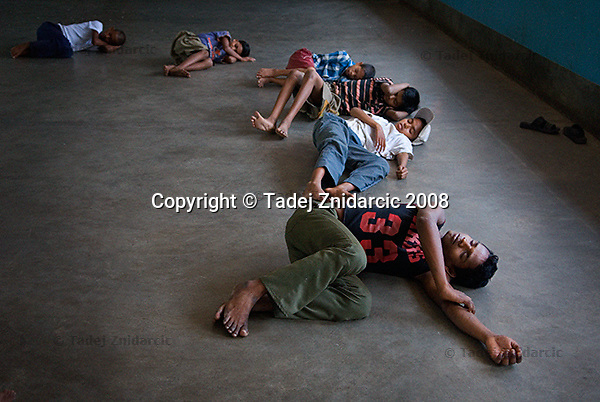 Street children relax during a dance movement therapy session organized by Kolkata Sanved at Don Bosco Ashalayam center. Howrah, India.