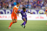 Orlando, Florida - Saturday, April 23, 2016: Orlando Pride forward Jasmyne Spencer (23) protects the ball from Houston Dash defender Poliana Barbosa (2) during an NWSL match between Orlando Pride and Houston Dash at the Orlando Citrus Bowl.