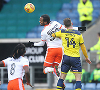 Blackpool's Nathan Delfouneso jumps with  Oxford United's Josh Ruffels<br /> <br /> Photographer Mick Walker/CameraSport<br /> <br /> The EFL Sky Bet League One - Oxford United v Blackpool - Saturday 6th January 2018 - Kassam Stadium - Oxford<br /> <br /> World Copyright &copy; 2018 CameraSport. All rights reserved. 43 Linden Ave. Countesthorpe. Leicester. England. LE8 5PG - Tel: +44 (0) 116 277 4147 - admin@camerasport.com - www.camerasport.com
