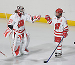 MADISON, WI - SEPTEMBER 29: Jesse Vetter #30 and Sara Bauer #15 of he Wisconsin Badgers women's hockey celebrate a goal against the Quinnipiac Bobcats at the Kohl Center on September 29, 2006 in Madison, Wisconsin. The Badgers beat the Bobcats 3-0. (Photo by David Stluka)