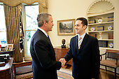 """United States President George W. Bush welcomes Jason Kamras, the 2005 National Teacher of the Year, to the Oval Office during ceremonies Wednesday, April 20, 2005, at the White House in Washington, D.C.  Mr. Kamras, originally from Sacramento, California, is a 1996 graduate of Princeton University. While in college he worked as an AmeriCorps Volunteer in Service to America (VISTA) teacher.  Following graduation, he joined Teach for America at John Philip Sousa Middle School in Washington, D.C.   He has remained at Sousa since then, with time off in 1999-2000 to earn a Master's degree from Harvard.  He teaches seventh and eighth grade math.  """"Teaching is a commitment to equity and opportunity for all children,"""" says Mr. Kamras.  """"It is a promise of a better future for those who have been left behind... .Mandatory Credit: Eric Draper / White House via CNP"""