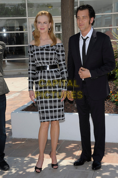 Nicole Kidman & Clive Owen.'Hemingway & Gellhorn' Photocall during the 65th Annual Cannes Film Festival at Palais des Festivals, Cannes, France..25th May 2012.full length white check dress black belt off the shoulder suit.CAP/PL.©Phil Loftus/Capital Pictures.