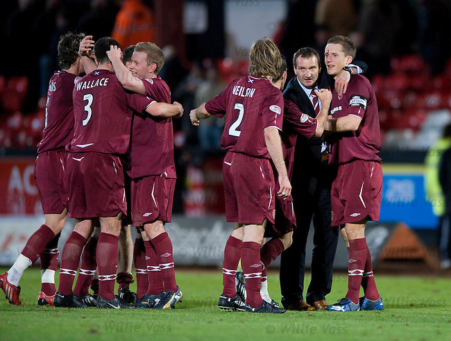 Hearts coach Csaba Laszlo celebrates on the pitch with his players at full-time