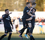 Robbie Crawford celebrates with Lewis MacLeod and Andy Little as Kyle Hutton adds his approval
