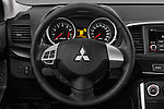 Car pictures of steering wheel view of a 2016 Mitsubishi Lancer Intense 4 Door Sedan Steering Wheel