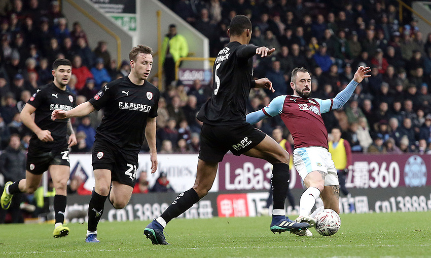 Burnley's Steven Defour under pressure from Barnsley's Ethan Pinnock<br /> <br /> Photographer Rich Linley/CameraSport<br /> <br /> Emirates FA Cup Third Round - Burnley v Barnsley - Saturday 5th January 2019 - Turf Moor - Burnley<br />  <br /> World Copyright © 2019 CameraSport. All rights reserved. 43 Linden Ave. Countesthorpe. Leicester. England. LE8 5PG - Tel: +44 (0) 116 277 4147 - admin@camerasport.com - www.camerasport.com