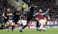 Burnley's Steven Defour under pressure from Barnsley's Ethan Pinnock<br /> <br /> Photographer Rich Linley/CameraSport<br /> <br /> Emirates FA Cup Third Round - Burnley v Barnsley - Saturday 5th January 2019 - Turf Moor - Burnley<br />  <br /> World Copyright &copy; 2019 CameraSport. All rights reserved. 43 Linden Ave. Countesthorpe. Leicester. England. LE8 5PG - Tel: +44 (0) 116 277 4147 - admin@camerasport.com - www.camerasport.com