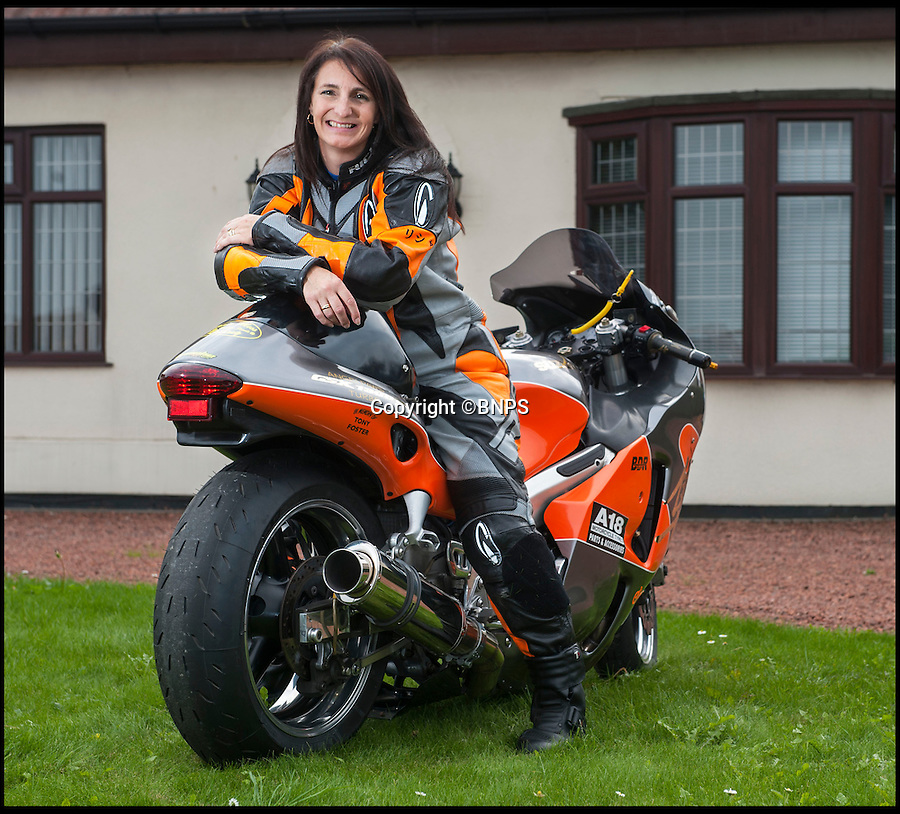 BNPS.co.uk (01202 558833)<br /> Pic: PhilYeomans/BNPS<br /> <br /> True Brit...<br /> <br /> A 46-year-old mum of two has become the world's fastest woman on two wheels after going a blistering 264mph on a motorbike her husband built in their garage.<br /> <br /> IT analyst Becci Ellis showed nerves of steel as she set the incredible speed on her modified Suzuki bike, smashing the existing world land speed record by a whopping 20mph.<br /> <br /> Becci, from Scunthorpe, Lincs, bought the off-the-shelf bike second hand in 2008 to use as spares but after testing it on a track she realised it had potential to be a record-breaker.<br /> <br /> Her husband Mick has spent the last two years tweaking the 1300cc bike and developing a one-of-a-kind turbo system to boost Becci to breakneck speeds.<br /> <br /> And his hard work finally paid off when Becci blasted down the mile-long course at Elvington airstrip in York at 264.1mph, destroying American rider Jennifer Robertson's existing record of 243.6mph.