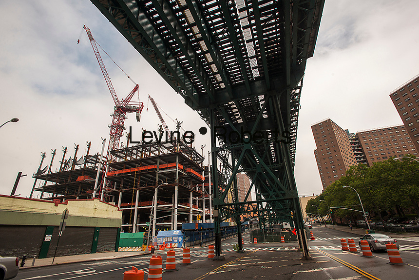 The view from Broadway of construction in the 17 acre area, partially acquired  through the use of eminent domain, in Manhattan Valley in New York where Columbia University is building a bio-tech lab as well as a general university expansion. The trestle for the IRT Number 1 train runs overhead. (© Richard B. Levine)