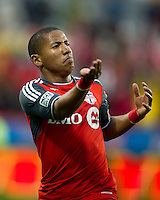 Toronto FC forward Joao Plata #7 gestures to the crowd after scoring a goal during an MLS game between the Chicago Fire and the Toronto FC at BMO Field in Toronto on May 14, 2011..The game ended in a 2-2 draw.