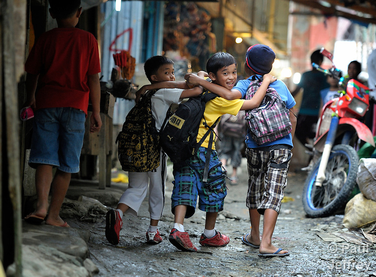 Children walk home from school in Diwalwal, a remote gold mining community on the Philippines' southern island of Mindanao. Also known as Mt. Diwata, the community has become the center of an international struggle between small scale miners and large international mining corporations....